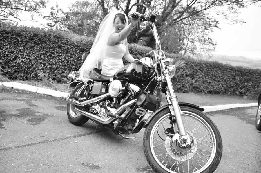 Raicheal Cronin on her Dad's cherished Harley Davidson on her wedding day